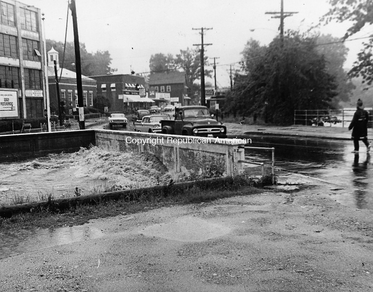 Intense rainfall deluged Watertown and parts of Waterbury, causing streams to spill over their banks and flood low-lying areas in July of 1963. Watertown's Steele Brook built up a tremendous head and battered the Main Street bridge in Oakville, forcing police to detour traffic.
