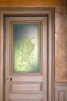 Many of the original features of the house such as this etched glass door panel have been retained