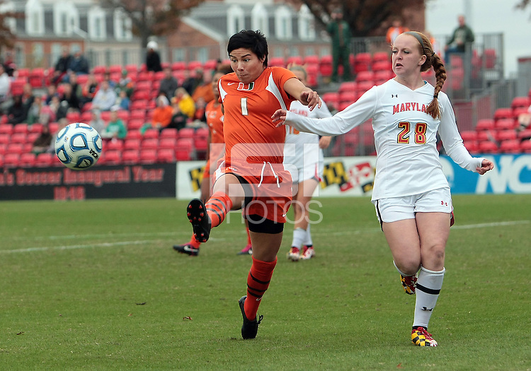COLLEGE PARK, MD - OCTOBER 28, 2012:  Shannon Collins (73) of the University of Maryland chases after Kate Howarth (1) of Miami during an ACC  women's tournament 1st. round match at Ludwig Field in College Park, MD. on October 28. Maryland won 2-1 on a golden goal in extra time.