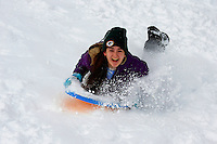 Grace Walner sleds down Olbrich Park hill after the winter snowstorm on Sunday, December 22, 2013, in Madison, Wisconsin