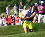 July 7, 2012; Kohler, WI, USA; Michelle Wie watches her ball as she chips on to the 18th green during the third round of the U.S. Women's Open at Blackwolf Run in Kohler, Wisconsin. Mandatory Credit: Mary Langenfeld-US PRESSWIRE