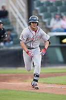 Michael Chavis (11) of the Greenville Drive hustles down the first base line against the Kannapolis Intimidators at CMC-Northeast Stadium on April 28, 2015 in Kannapolis, North Carolina.  The Intimidators defeated the drive 3-2.  (Brian Westerholt/Four Seam Images)
