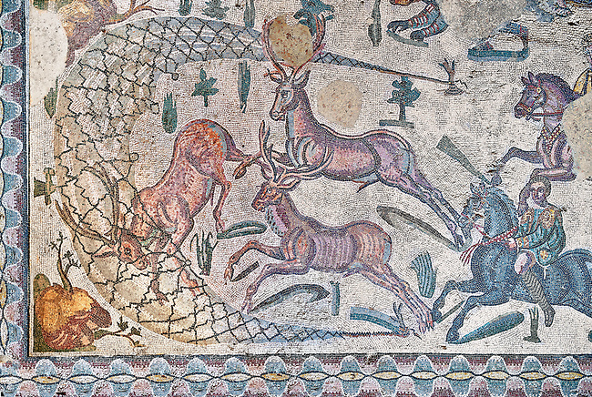 Deer being hunted. Roman mosaic floor of the Room of The Small Hunt, no 25 - Roman mosaics at the Villa Romana del Casale ,  circa the first quarter of the 4th century AD. Sicily, Italy. A UNESCO World Heritage Site.
