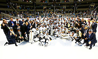 Members of the Pittsburgh Penguins pose for a team photo following their 3-1 win against the San Jose Sharks during game six of the Stanley Cup Final at SAP Center in San Jose, California on June 12, 2016. (Photo by Jared Wickerham / DKPS)