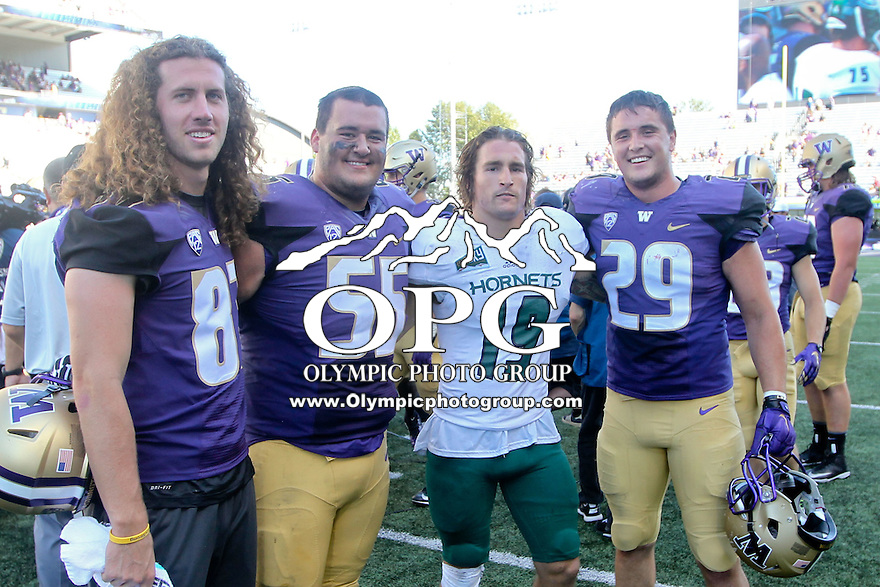 SEP 12, 2015:  Nick Crouch poses with Washington's Connor O'Brien, Dane Crane, Forrest Dunivin at Husky Stadium in Seattle, Washington. Washington won over Sacramento State 49-0.