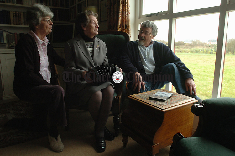 With story re TJ....................Local woman Kitty Hayes plays a tune on the concertina for Pat Mackenzie Carroll and Jim Carroll at home in Miltown Malbay. Photograph by John Kelly.