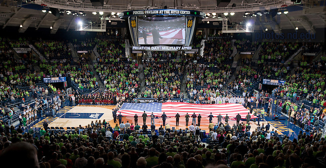 Nov. 18, 2012; Current and former military members hold a large U.S. flag before the Women's Basketball game against UMass...Photo by Matt Cashore/University of Notre Dame