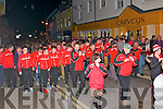 Pobalscoil Chorca Dhuibhne footballers and supporters walking the streets of Dingle with the Dingle Drums & Fife Town Band  after winning the Corn Uí hÓgain All-Ireland in Croke Park on Saturday night.
