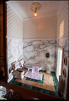 BNPS.co.uk (01202) 558833<br /> Picture: Peter Willows<br /> <br /> Georgian Manor complete with marble bathrooms...<br /> <br /> Every little girls Xmas wish...A meticulously crafted dolls house that has taken Len Martin from Dorset 26 years to complete in his garden shed.<br /> <br /> Len is now selling his masterpiece in time for Xmas..but any bidders for 'Langdon Hall' will need deep pockets to come up with the &pound;10,000 asking price.<br /> <br /> Leonard Martin, 68, was inspired to make the ornate house after he doodled a picture of his 'perfect home' on a scrap of paper while he was bored at work in 1987.<br /> <br /> He has worked on the miniature property up to five hours a day since then to build the extravagant home and make his dreams a reality.<br /> <br /> The 6ft 2ins long and 3ft 6ins tall building has two bedrooms, two bathrooms, a kitchen, sitting room, dining room, and hallway all filled with tiny furniture.<br /> <br /> Leonard has spared no expense on the detailed Georgian manor and has spent more than 6,000 pounds building and filling the rooms.<br /> <br /> He has splashed out on detailed finishes and period furnishings including a Swarvoski crystal chandelier, hand stitched carpets, and real marble flooring.<br /> <br /> There are miniature beds, settees, cupboards, baths, toilets, and even tiny oil paintings that look like their huge counterparts - including the Mona Lisa.<br /> <br /> After working on the incredibly intricate Langdon House for more than a third of his life, Leonard has now decided to sell it and hopes to fetch around 9,000 pounds.<br /> <br /> Leonard, who used to own a miliary memorabilia shop and lives in Charlton Marshall near Blandford,Dorset, said: &quot;It all began when I was in my shop one