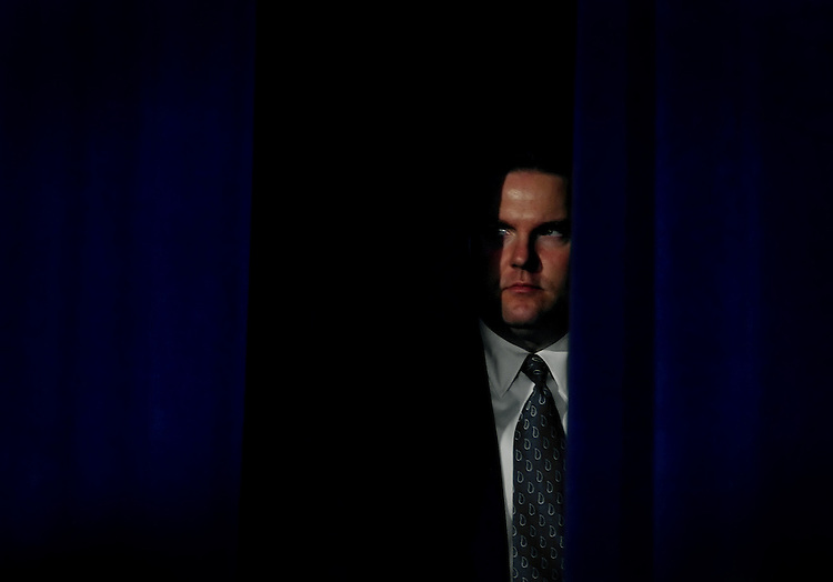 A Secret Service agent watches President George W. Bush speak at the American Builders and Contractors 2005 legislative conference.