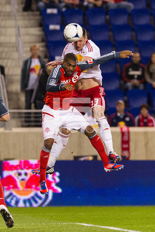 Kenny Cooper (33) of the New York Red Bulls goes up for a headerduring a Major League Soccer (MLS) match at Red Bull Arena in Harrison, NJ, on September 29, 2012.