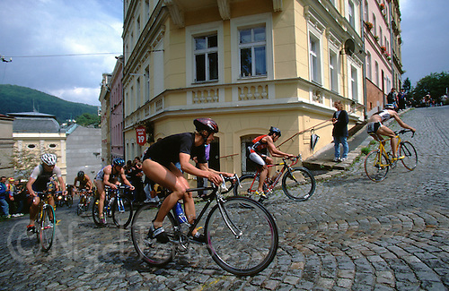 29 JUL 2000 - KARLOVY VARY, CZE - Competitors climb the cobbled streets of the city during the European Triathlon Union Cup round (PHOTO (C) NIGEL FARROW)