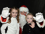Hayley and Chloe Hughes pictured with Santa at the Castle Manor childrens Christmas party in the Rugby Club. Photo:Colin Bell/pressphotos.ie