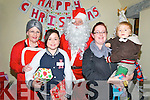 Tarbert Santa Visit: Pictured at the visit of Santa Claus to the Bridewell Centre in Tarbert on Sunday last were Mrs santa Claus, Kyla Kiely, Santa Claus, Catherina Fitzgerald with Sean Kiely. ..