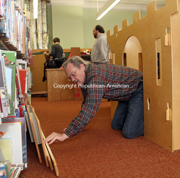 Winsted, CT-032313MK03 Bob Geiger, vice president of the library board, disassembles a wooden castle as fifteen staff and volunteers renovate The Beardsley and Memorial Library's two children and youth rooms on the second floor on Saturday morning in Winsted. Director Karin Taylor said renovations began in December and have consisted of mainly repainting the walls and over the next days contractors will lay new carpet. There also are new furnishing, blinds and decorative items to be installed. Springtime plans also include having Gilbert School students paint a mural in the children's room and Region 7 students will create a decorative wall hanging in the youth room. The children's room will be closed until March 27 and is expected to reopen at noon.  Michael Kabelka Republican American