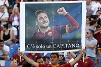 Calcio, Serie A: Roma, stadio Olimpico, 28 maggio 2017.<br /> Roma fan with a banner featuring Roma&rsquo;s Francesco Totti before the start the Italian Serie A football match between AS Roma and Genoa at Rome's Olympic stadium, May 28, 2017.<br /> Francesco Totti's final match with Roma after a 25-season career with his hometown club.<br /> UPDATE IMAGES PRESS/Isabella Bonotto
