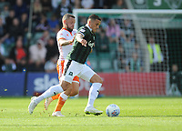 Plymouth Argyle's Antoni Sarcevic under pressure from Blackpool's Jay Spearing<br /> <br /> Photographer Kevin Barnes/CameraSport<br /> <br /> The EFL Sky Bet League One - Plymouth Argyle v Blackpool - Saturday 15th September 2018 - Home Park - Plymouth<br /> <br /> World Copyright &copy; 2018 CameraSport. All rights reserved. 43 Linden Ave. Countesthorpe. Leicester. England. LE8 5PG - Tel: +44 (0) 116 277 4147 - admin@camerasport.com - www.camerasport.com