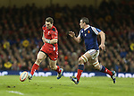Wales center George North kicks the ball past French number 8 Louis Picamoles.<br /> RBS 6 Nations 2014<br /> Wales v France<br /> Millennium Stadium<br /> 21.02.14<br /> <br /> &copy;Steve Pope-SPORTINGWALES