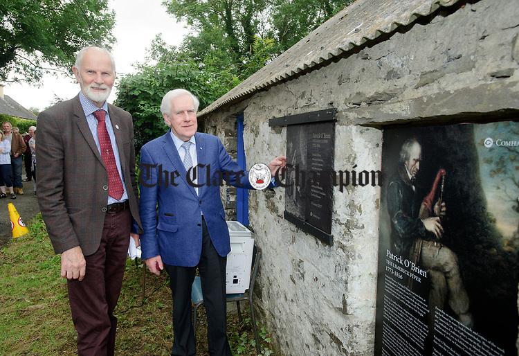 Frank Whelan, chairman of Fleadh 2017 Ennis and Labhrás Ó Murchú, Director-General of Comhaltas Ceoltóirí Éireann unveil  a memorial at the house where the blind piper Patrick O Brien was born at Labasheeda. Photograph by John Kelly.