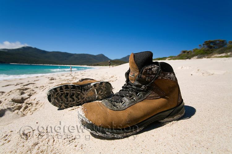 Hiking boots on the white sands of Wineglass Bay.  Freycinet National Park, Tasmania, AUSTRALIA