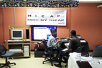 Miss Merle Bush assists a technician as he is installing new Apple hardware before an HICAP class at The Gen Chauncey M. Hooper Towers, that hosts the Harlem Internet Computer Access program taught by instructor Merle Bush in Harlem, Manhattan, NY, USA on November 16, 2011.