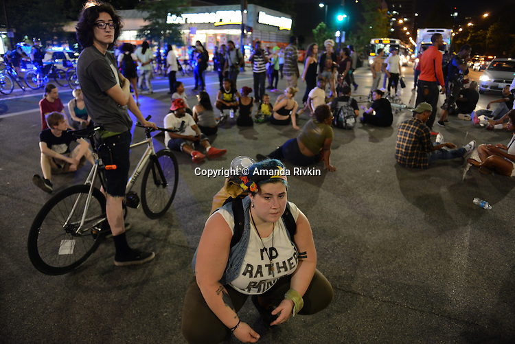 Protesters marched with their families and friends before staging a sit in at Roosevelt and State Street in the South Loop in Chicago, Illinois on July 9, 2016.  Protests erupted nationwide following the police shootings of Alton Sterling who was selling bootleg DVDs outside a convenience store in Baton Rouge, Louisiana and Philando Castile during a routine traffic stop for a broken tail light in the St. Paul, Minneapolis suburb of Falcon Heights; on Thursday night, a lone gunman Micah Johnson fired and killed five police officers and injured several others during a Black Lives Matter protest in Dallas.