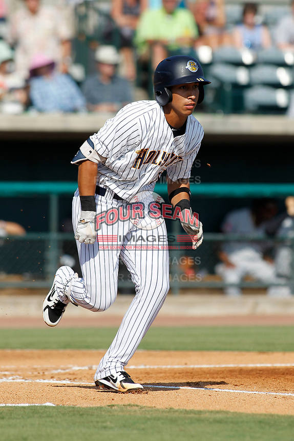 "Charleston Riverdogs infielder Oswaldo Cabrera (10) at bat during a game against the Hickory Crawdads at the Joseph P. Riley Ballpark in Charleston, South Carolina. For Sunday games, the Riverdogs wear their ""Holy City"" uniforms in honor of the city's nickname. Hickory defeated Charleston 8-7. (Robert Gurganus/Four Seam Images)"
