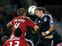 Santa Clara, California - Saturday July 18, 2012: FC Dallas' Andrew Jacobson and San Jose Earthquakes' Alan Gordon jump for the ball during a game at Buck Shaw Stadium, Stanford, Ca   San Jose Earthquakes defeated FC Dallas 2 - 1.