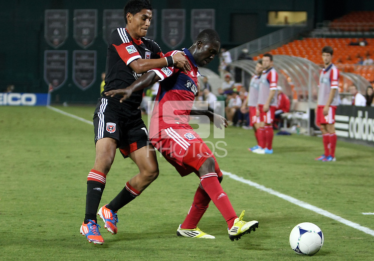 WASHINGTON, DC. - AUGUST 22, 2012:  Andy Najar (14) of DC United grabs  Patrick Nyarko (14) of the Chicago Fire during an MLS match at RFK Stadium, in Washington DC,  on August 22. United won 4-2.