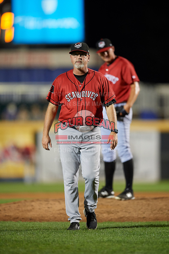 Erie SeaWolves pitching coach Willie Blair (20) walks back to the dugout after a mound visit during a game against the Harrisburg Senators on August 29, 2018 at FNB Field in Harrisburg, Pennsylvania.  Harrisburg defeated Erie 5-4.  (Mike Janes/Four Seam Images)
