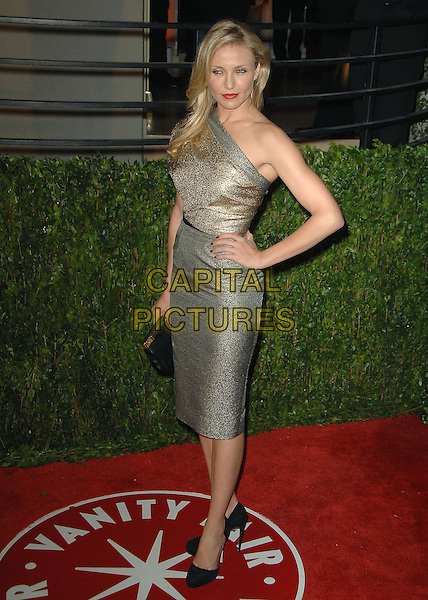 CAMERON DIAZ.The 2010 Vanity Fair Oscar Party held at The Sunset Tower Hotel in West Hollywood, California, USA..March 7th, 2010.oscars full length dress clutch bag gold glitter silver one shoulder skirt top hand on hip.CAP/RKE/DVS.©DVS/RockinExposures/Capital Pictures.