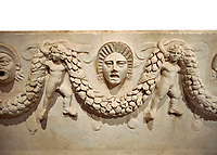 "Close up picture of Roman relief sculpted Sarcophagus of Garlands, 2nd century AD, Perge. This type of sarcophagus is described as a ""Pamphylia Type Sarcophagus"". It is known that these sarcophagi garlanded tombs originated in Perge and manufactured in the sculptural workshops of Perge. Antalya Archaeology Museum, Turkey.. Against a white background."