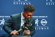 New York, NY - December 8, 2018:  University of Oklahoma quarterback Kyler Murray kisses the Heisman Trophy after winning the award at the New York Marriott hotel December 8, 2018. .  (Photo by Don Baxter/Media Images International)