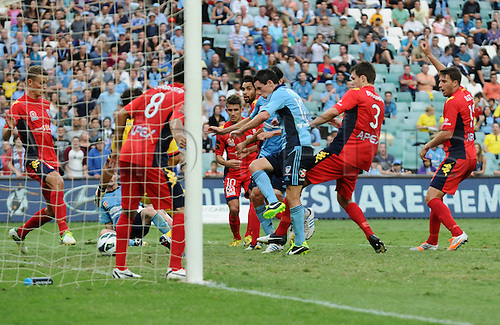16.02.2013 Sydney, Australia. Sydney forward Blake Powell scores the second goal during the Hyundai A League game between Sydney FC and Adelaide United from the Allianz Stadium.