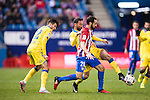 "Juan Francisco Torres Belen ""Juanfran"" of Atletico de Madrid competes for the ball with Helder Lopes (l) and Jeronimo Figueroa Cabrera ""Momo"" of UD Las Palmas during their Copa del Rey 2016-17 Round of 16 match between Atletico de Madrid and UD Las Palmas at the Vicente Calderón Stadium on 10 January 2017 in Madrid, Spain. Photo by Diego Gonzalez Souto / Power Sport Images"