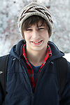 Portrait of Caucasian teenage boy in winter setting and warm clothing, UK