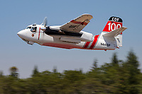 S-2F3AT Tracker, CDF 100, get airborne from the Grass Valley Air Attack Base in Northern California enroute to a wildfire.