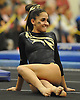Lauren Gomes of Commack begins her floor routine during the Suffolk County varsity girls' gymnastics individual championships at Babylon High School on Friday, November 6, 2015. She won the all-around with a score of 37.325.<br /> <br /> James Escher