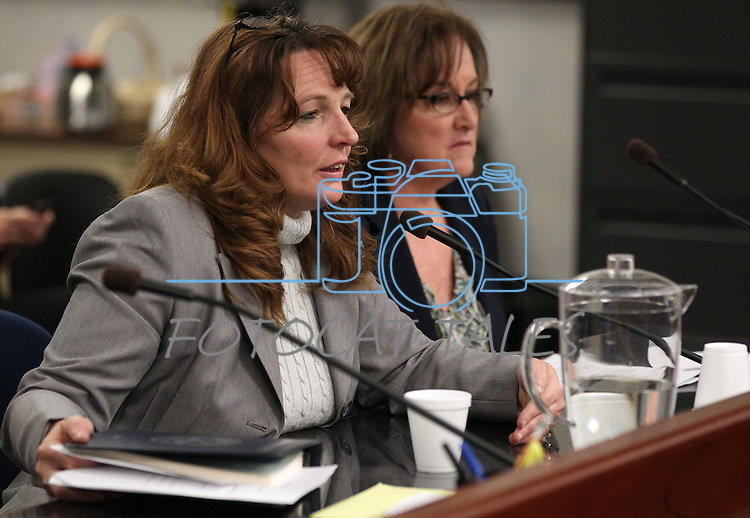 Nevada Assemblywomen Marilyn Kirkpatrick, D-North Las Vegas, left, and Debbie Smith, D-Sparks, testify in committee at the Legislature in Carson City, Nev. on Thursday, March 10, 2011..Photo by Cathleen Allison