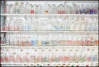 BNPS.co.uk (01202 558833)<br /> Pic: RachelAdams/BNPS<br /> <br /> Some of the bottles. <br /> <br /> In a glass of his own...<br /> <br /> Dairy-daft Peter Hayward is udderly devoted to his bizarre hobby - collecting vintage milk bottles.<br /> <br /> The 70-year-old has devoted the last 30 years to building up a whopping collection of more than 1,000 bottles.<br /> <br /> Peter, a former dairy worker, scours the south west of Britain in search of rare bottles emblazened with the colourful logos of old dairies.<br /> <br /> And since retiring 16 years ago his collection has swelled so much that he has been forced to turn his garage into a mini museum.<br /> <br /> Peter's obsession with milk started as a 10-year-old when he helped his local milkman on his weekend rounds to earn some pocket money.<br /> <br /> He later joined Express Dairies as a distribution manager, working alongside hundreds of independent dairy farmers.<br /> <br /> When he retired in the late 1990s Peter had amassed a sizeable collection in his office - and decided to devote his free time to growing it.