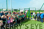 Official Opening: Edan O'Brien from Ballyduff cutting the ribbon to officially open the ne asro turf arena & Hurling wall at Ballyduff GAA grounds on Sunday last. Liam Lenihan, Chairman Munster Council Hurling and Tipperary star Ronan Maher assisting Edan.