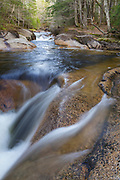 Cascade along the Pemigewasset River near the Flume Visitor Center in Franconia Notch State Park of Lincoln, New Hampshire during the spring months.