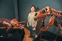 NWA Democrat-Gazette/MICHAEL WOODS • @NWAMICHAELW<br /> Brent Smith of Siloam Springs stands with some of his mahogany carved dinosaur skeletons on display at the Fayetteville Underground. October 1, 2015.