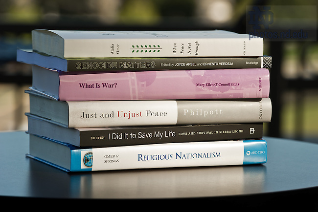 Aug. 23, 2013; A stack of books authored and/or edited by Kroc Institute fellows and faculty in 2012-13.<br /> <br /> Photo by Matt Cashore/University of Notre Dame
