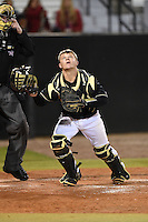 UCF Knights catcher Logan Heiser (23) looks for a foul ball pop up during the opening game of the season against the Siena Saints on February 13, 2015 at Jay Bergman Field in Orlando, Florida.  UCF defeated Siena 4-1.  (Mike Janes/Four Seam Images)
