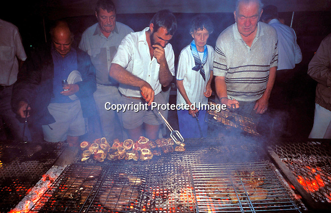 DIPOAFR00027.Culture Afrikaners Orania residents having a braai (barbeque) during an Afrikaner holiday in Orania, an all white Afrikaner community in teh Northern Cape, South Africa. Orania is a community of about 600 people where the residents are trying to to preserve Afrikaner culture and language..Photo: Per-Anders Pettersson/ iAfrika Photos