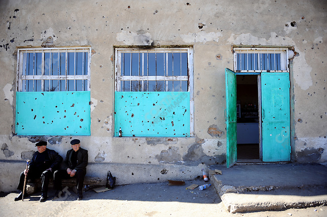 In the village of Khetagurova to the west of the South Ossetian capital, Tskhinval, that was the sight of fierce fighting with the Georgian forces in August 2008, locals sat in front of the village store. February 13, 2008
