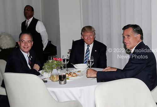 United States President-elect Donald Trump sits at a table with former Governor Mitt Romney (Republican of Massachusetts) and Reince Priebus (L) at Jean Georges Restaurant on November 29, 2016 in New York City. U.S. President-elect Donald Trump spent the afternoon holding meetings at Trump Tower as he continues to fill in key positions in his new administration.     <br /> Credit: John Angelillo / Pool via CNP