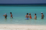 These visitors were enjoying a water stroll alone West Bay Beach on the island of Roatan in Honduras.