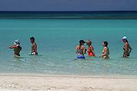 These visitors were enjoying a water stroll alone West Bay Beach on the island of Roatan in Honduras.